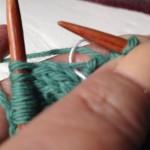 thread over working yarn