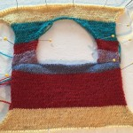 top of the sweater showing front and back